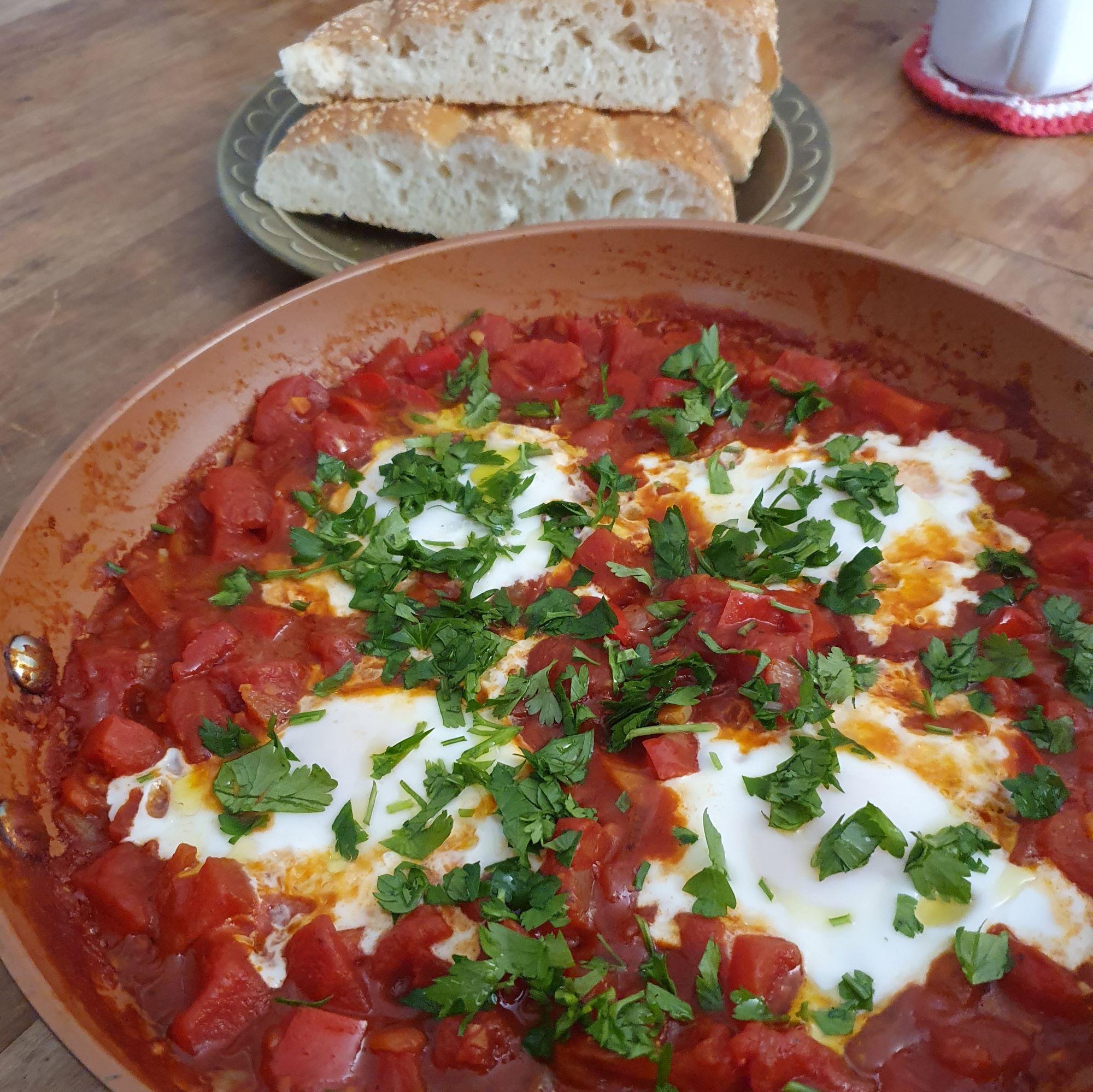 Shashuka vegetarian middle eastern tomatoe poached egggs